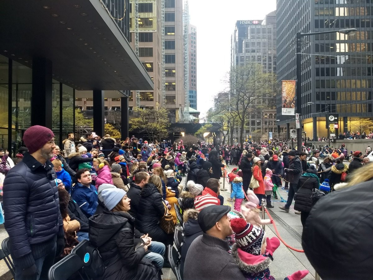 A crowd on Wellington Street West awaits the arrival of Santa Claus.